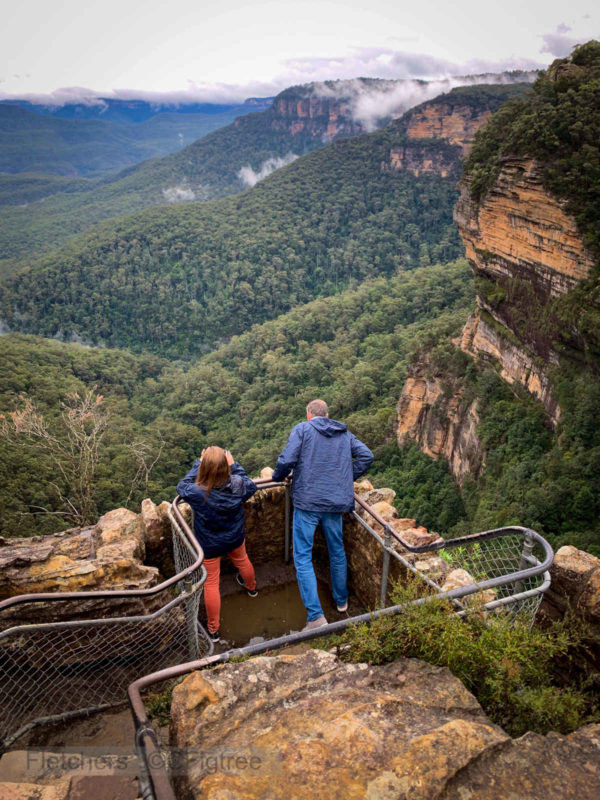 Couple overlooking the valley at Wentworth Falls