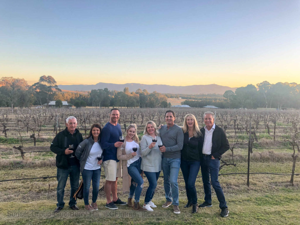 Group at Sunset at Blue Berry Hill with the grapevines on our Hunter Valley Private Tour