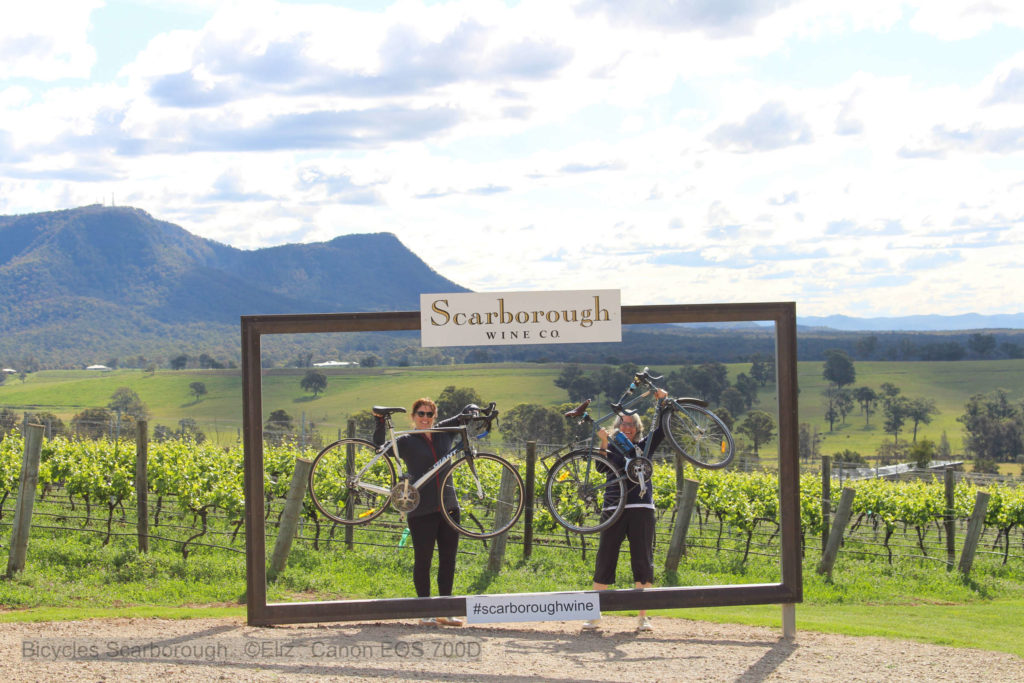 Riders holding up their bikes at Scarborough wines